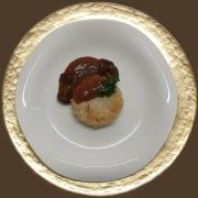 Tortino di riso al salto con salsa di funghi al timo
